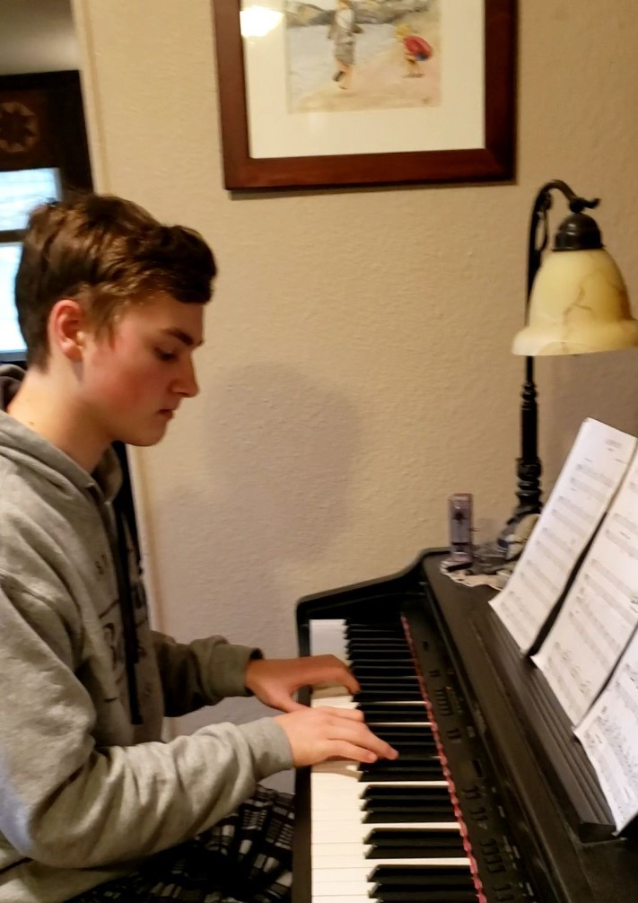 Caleb playing the piano