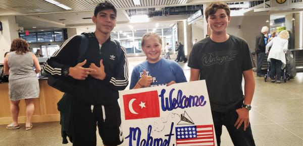 Mehmet and host siblings at the airport when he arrived