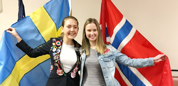Scandinavian students with their home country flags