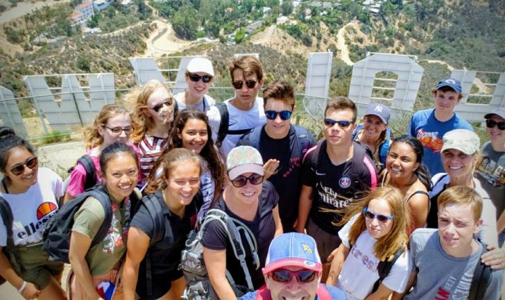 Group photos behind Hollywood sign