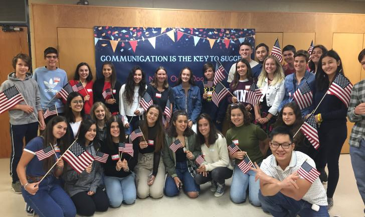 Orientation group with U.S. flags